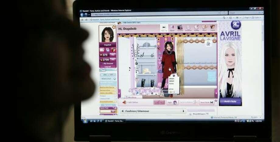 "Megan, 12, dresses up her ""MeDoll"" at the preteen networking site. Photo: KAREN WARREN, CHRONICLE"