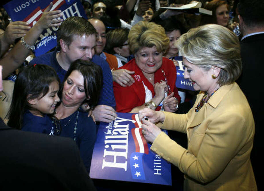 """Hillary Clinton greets supporters during a """"Solutions for America"""" rally Wednesday at St. Mary's University in San Antonio. Presidential hopefuls have begun to campaign for Texas' March 4 primary. Photo: Ben Sklar, Getty Images"""