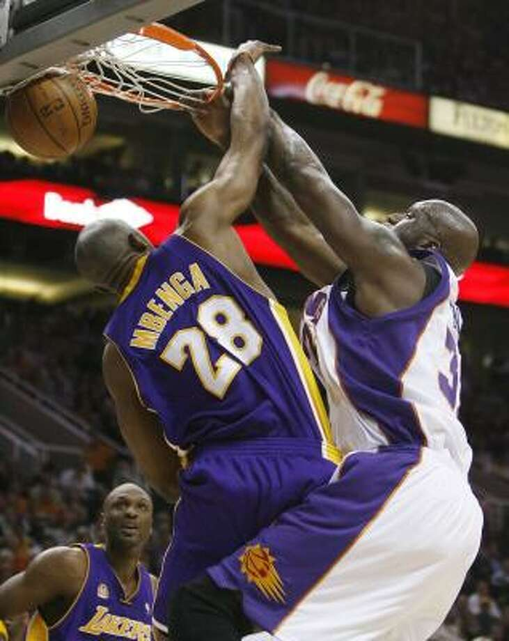 Shaquille O'Neal gives the Lakers' DJ Mbenga an idea of the kind of power game he brings to the Suns. Photo: ROSS D. FRANKLIN, ASSOCIATED PRESS
