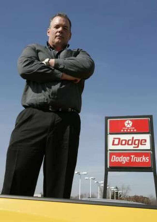 Kevin Beltz, owner of a Dodge dealership in Indianapolis, likes selling only Dodges, but Chrysler's new owners want operations that sell all three company brands. Photo: MICHAEL CONROY, ASSOCIATED PRESS