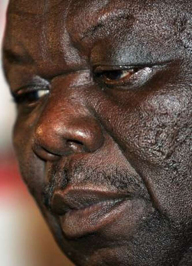 In his first public comments since Saturday's election, Morgan Tsvangirai said he was waiting for an official announcement of the results from the Zimbabwe Electoral Commission before he would enter any talks with Mugabe. Photo: ALEXANDER JOE, AFP/Getty Images