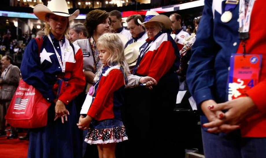 Texas delegates bow their heads during a prayer on the fourth day of the Republican National Convention in St. Paul, Minn. Photo: CHIP SOMODEVILLA, GETTY IMAGES