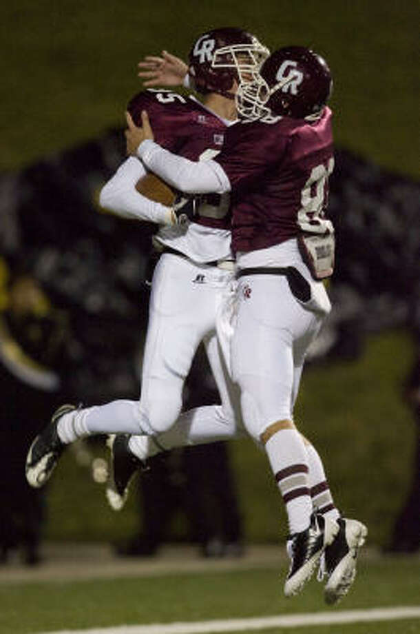 Cinco Ranch's Tyler Mack (left) jumps in the air and celebrates with teammate Joe Norrell (right) after Mack scored a touchdown against Eisenhower during the second quarter on Friday. Photo: James Nielsen, Chronicle