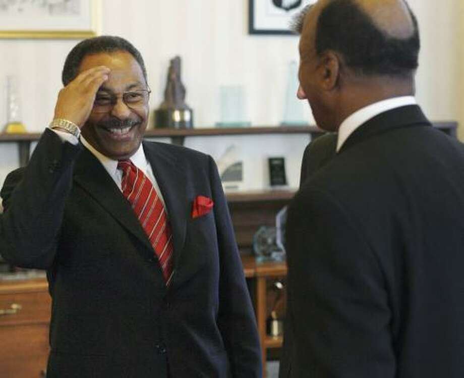 Roland Burris, who lost his last four elections, salutes Illinois Secretary of State Jesse White at a reception in 2007 for new officials. Photo: TED SCHURTER, STATE JOURNAL-REGISTER FILE