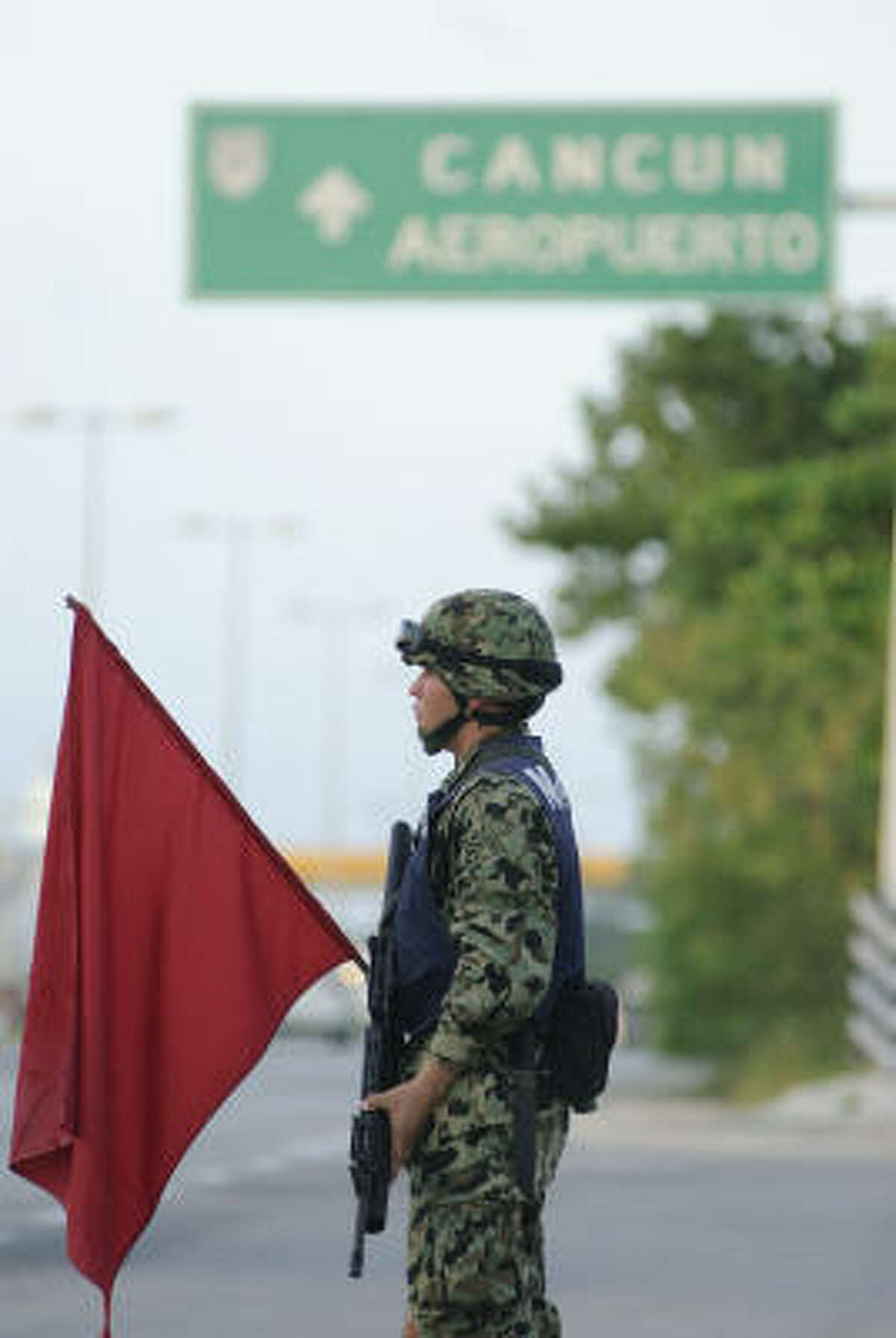 A Mexican official monitors a highway checkpoint south of town, searching for drugs and weapons after the general's death.