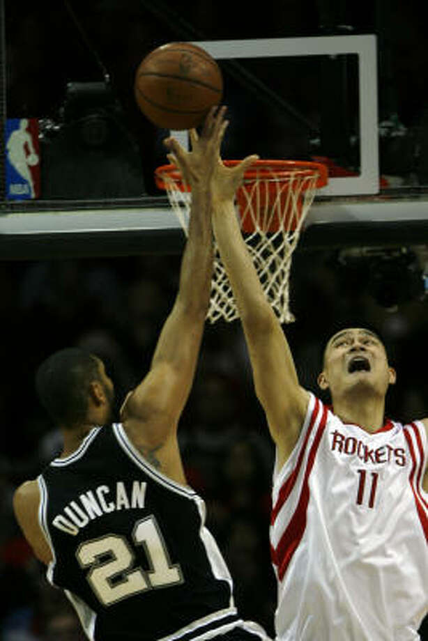 Spurs forward Tim Duncan (21) gets rejected at the rim courtesy of Yao Ming in the first half. Photo: Eric Kayne, Chronicle