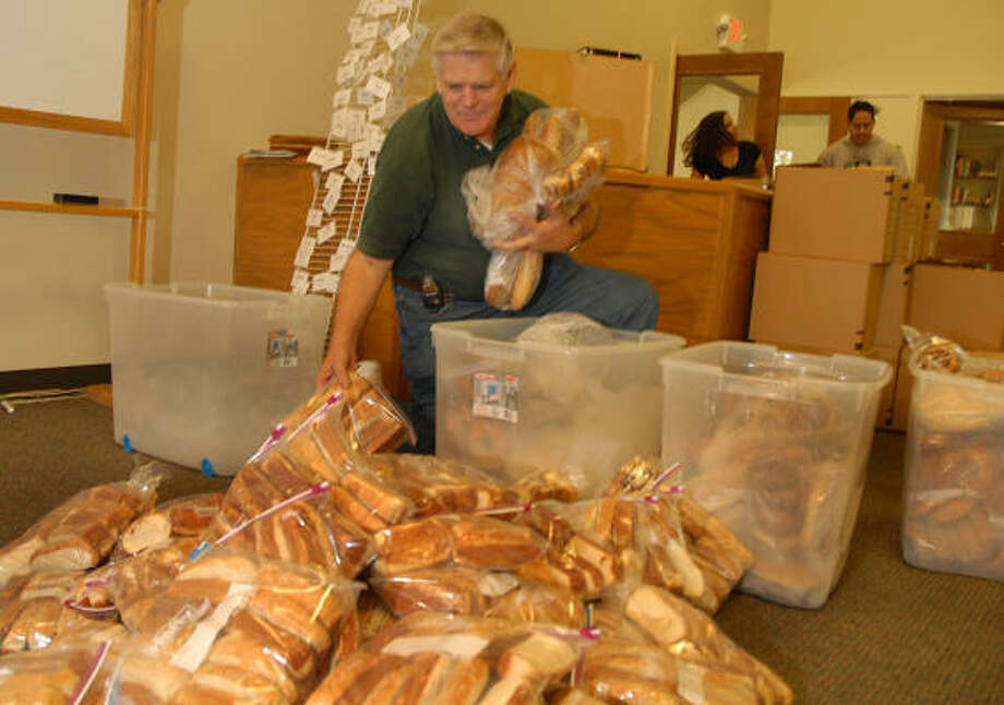 Leroy Zweifel fills a food order during the Angel Food Ministeries distrubtion day at the First Baptist Church, 11801 Grogans Mill Road, in The Woodlands. Angel Food Ministeries is a national organization that delivers groceries at a discounted. The deliveries are handled by local churches. Photo: David Hopper, For The Chronicle