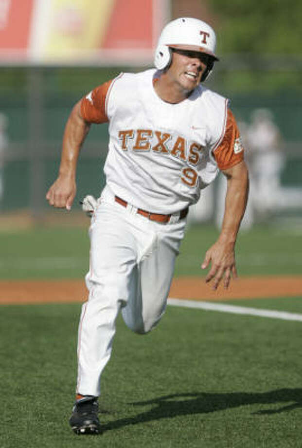 Texas' Michael Torres heads for home to score on Brandon Belt's triple in the first inning. Photo: Chris Carson, AP