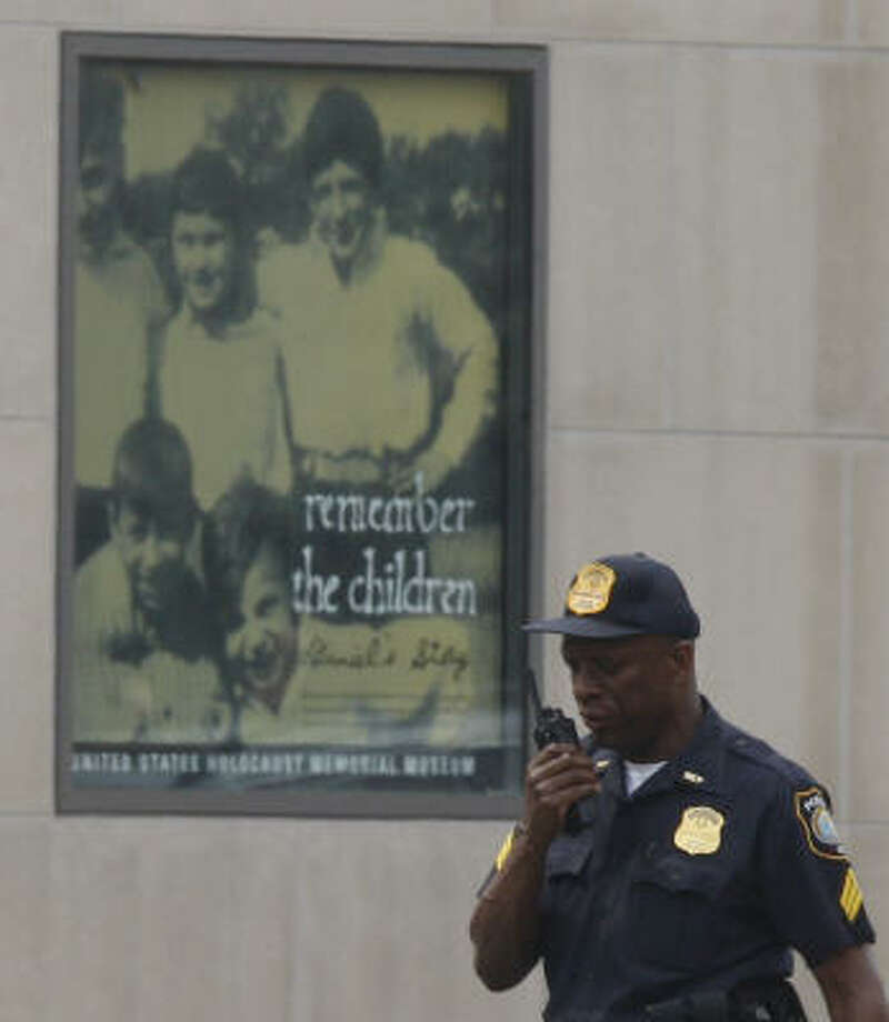A guard patrols the outside of the museum. The museum opened in 1993 and has drawn nearly 30 million visitors. Photo: Charles Dharapak, AP