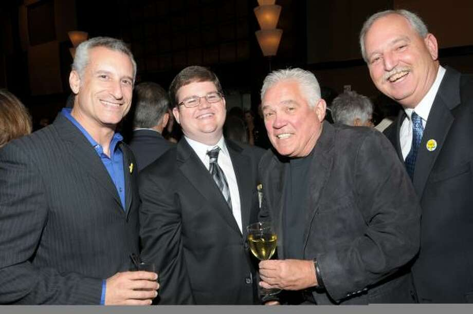 """GALA FUN: G.W. Bailey, second from right, star of """"The Closer"""" television series and executive director of The Sunshine Kids Foundation, visits with friends at the 17th annual Sunshine Kids Gala. Pictured with Bailey are, from left, Andy Sacks, producer of """"The Closer;""""  Steve Jones, former Sunshine Kid; and Russell Gordy."""