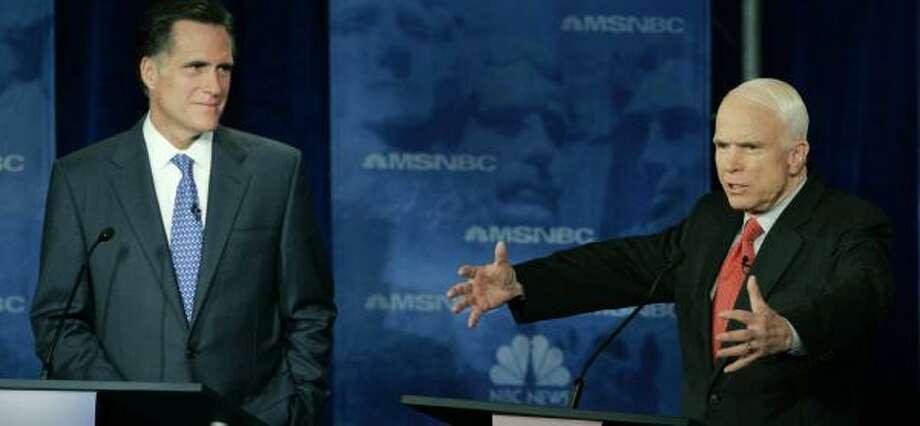 Sen. John McCain, right, responds to a question during a January debate as a fellow Republican presidential hopeful, former Massachusetts Gov. Mitt Romney, listens. Photo: LYNNE SLADKY, ASSOCIATED PRESS FILE