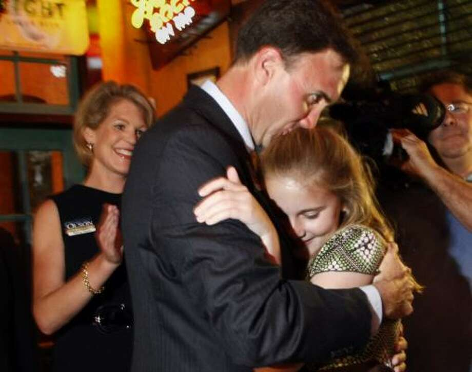 Pete Olson — who won the Republican candidacy in the 22nd Congressional District — celebrates his victory Tuesday night in Sugar Land with wife, Nancy, left, and daughter Kate. Photo: KEVIN FUJII, CHRONICLE