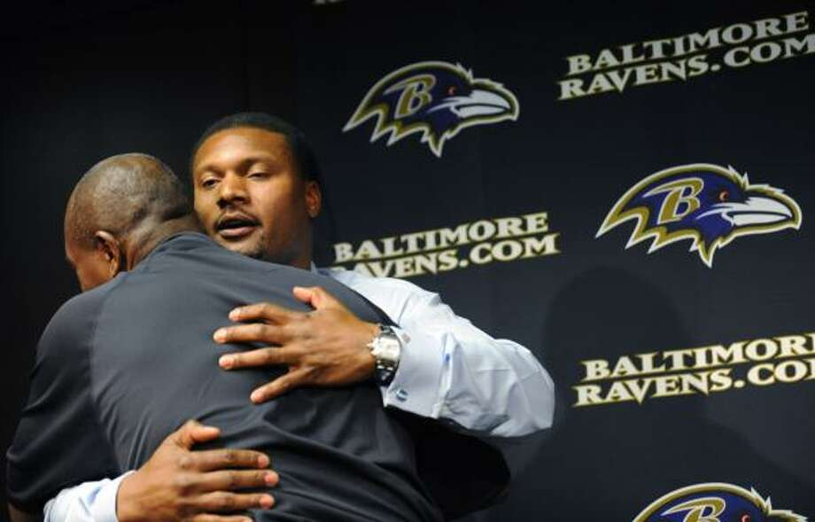 Ravens quarterback Steve McNair, facing camera, hugs General Manager Ozzie Newsome after announcing his retirement from football on Thursday. McNair's retirement left the Eagles' Jon Runyan as the only active Oilers player in the NFL. Photo: Gail Burton, AP