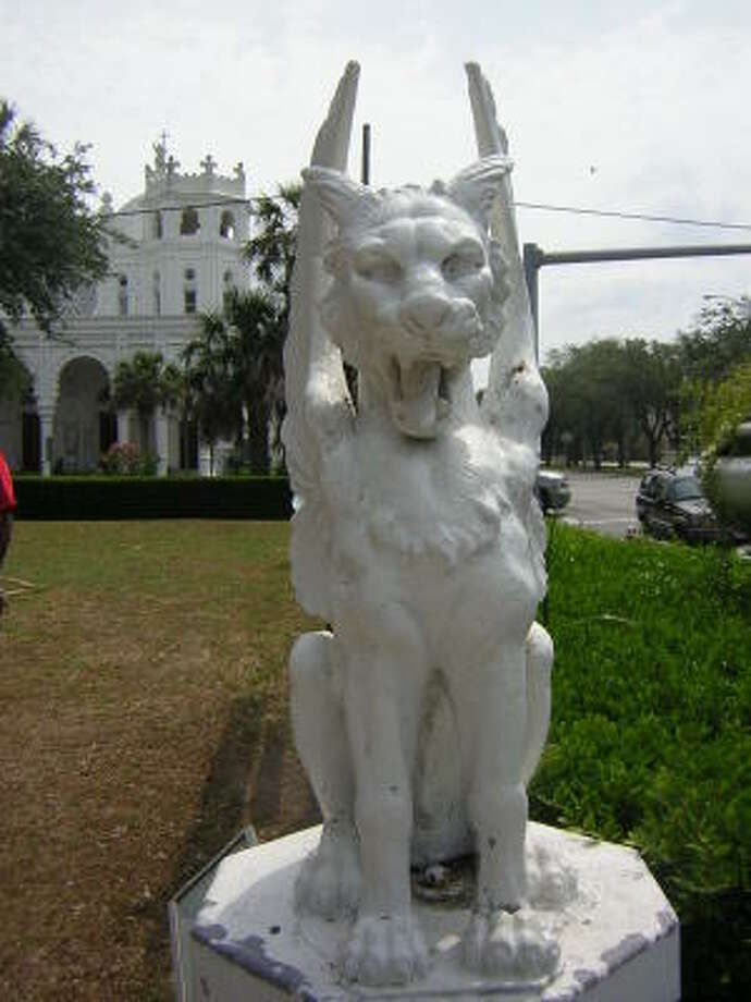 One of the two griffin statues that have guarded the Bishop's Palace in Galveston for more than 100 years apparently has been stolen, Galveston police say. Photo: Galveston Historical Foundation
