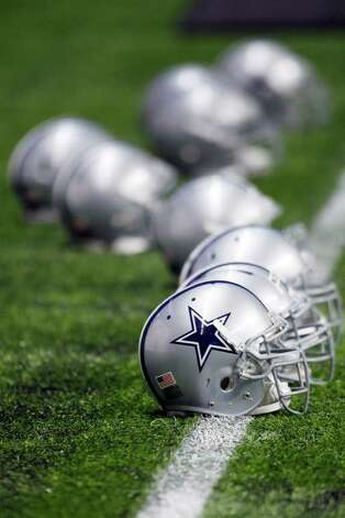 Dallas Cowboys helmets are seen during a practice, Thursday, July 28, 2011, in San Antonio. Photo: AP