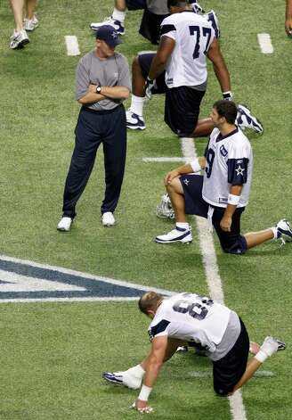 Dallas Cowboys coach Jason Garrett, left, talks with Tony Romo (9) during a practice, Thursday, July 28, 2011, in San Antonio. Photo: AP