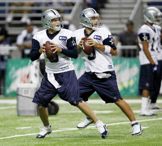 Dallas Cowboys' Jon , left, and Tony Romo, right, a practice, Thursday, July 28, 2011, in San Antonio. Photo: AP