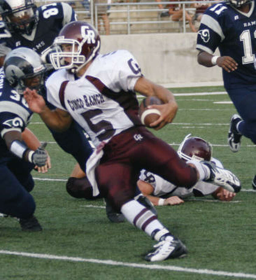 Cinco Ranch quarterback Shane Ros is back to run the Cougars' offense after getting hurt last season. Photo: Jose Francis, For The Chronicle
