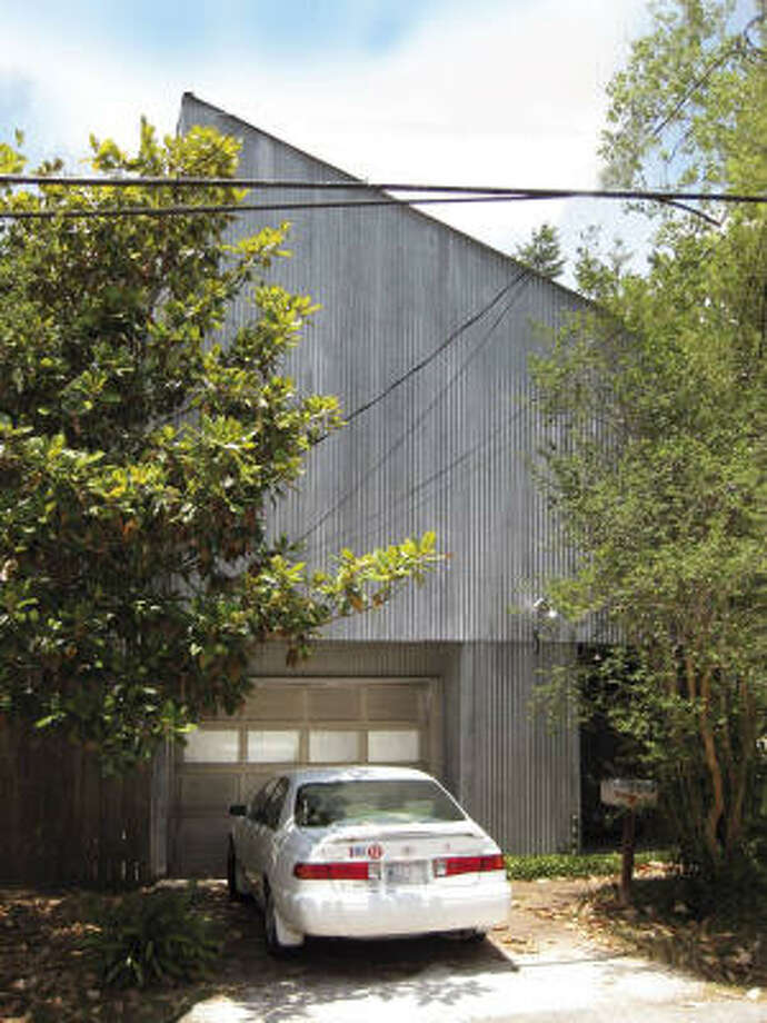 507 Roy : This duplex, the first-ever tin house and a hub of Houston 's '70s and '80s art scene, was sold as a teardown and recently razed. Designed by S.I. Morris Associates architects Eugene Aubry and Hossein Oskouie in 1974, for Texas Gallery owner Fredricka Hunter. Photo: Don Quaintance