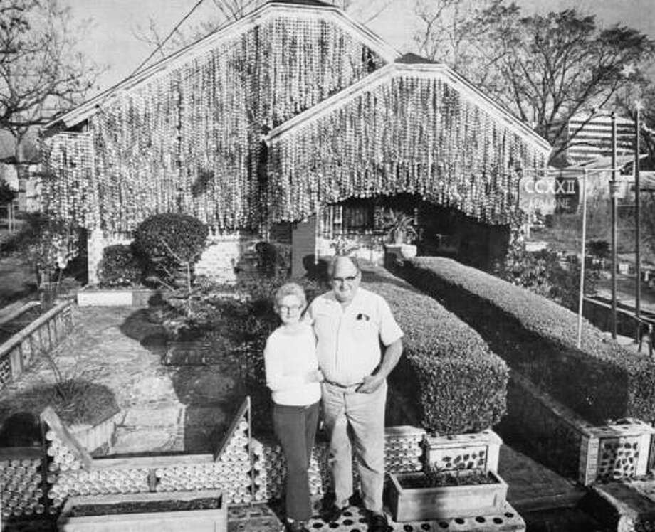 Mary and John Milkovisch in front of their Beer Can House at 2222 Malone. Photo: Ben DeSoto, Houston Chronicle