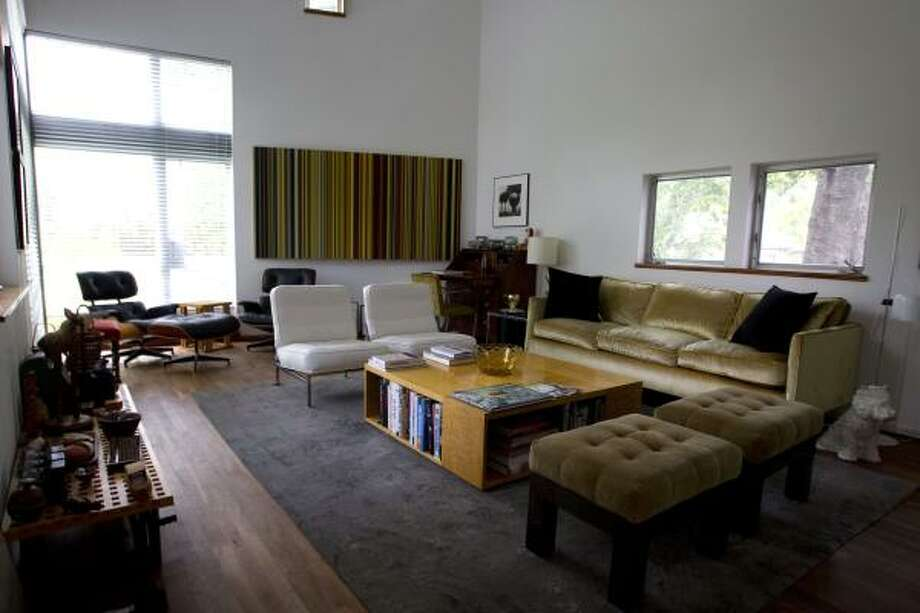 The living room in the Tin House owned by William Betts on Houston's West End Thursday, June 2, 2011, in Houston.  Betts Tin House was built in 1995, the first in Houston was built in 1974, for art dealer Fredricka Hunter, but it wasn't until the '90s that the neighborhood began to fill with silvery Galvalume. The international press soon followed. Hunter's house was recently razed to make room for townhouses. Photo: Johnny Hanson, Houston Chronicle