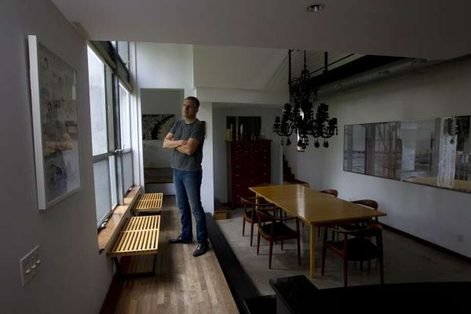 Artist William Betts in the dining area of his Tin House on Houston's West End Thursday, June 2, 2011, in Houston.  Betts Tin House was built in 1995, the first in Houston was built in 1974, for art dealer Fredricka Hunter, but it wasn't until the '90s that the neighborhood began to fill with silvery Galvalume. The international press soon followed. Hunter's house was recently razed to make room for townhouses. Photo: Johnny Hanson, Houston Chronicle