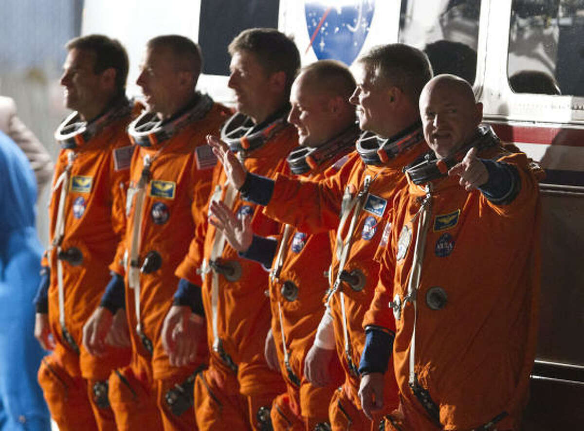 Commander Mark Kelly right, pilot Gregory Johnson, Mike Fincke, Roberto Vittori, Andrew Feustel and Gregory Chamitoff during the crew walkout for the space shuttle Endeavour's STS-134 mission to the international space station at NASA's Kennedy Space Center Monday, May 16, 2011, in Kennedy Space Center.