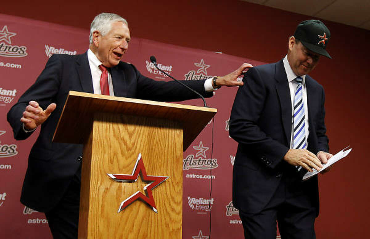 Astros owner Drayton McLane tries to stop Jim Crane from leaving the stage after he announced, during a press conference, the purchase agreement with a group headed by Houstonian Jim Crane, Monday, May 16, 2011, in Houston.The sale of the ball club will be finalized once it is approved by Major League Baseball.