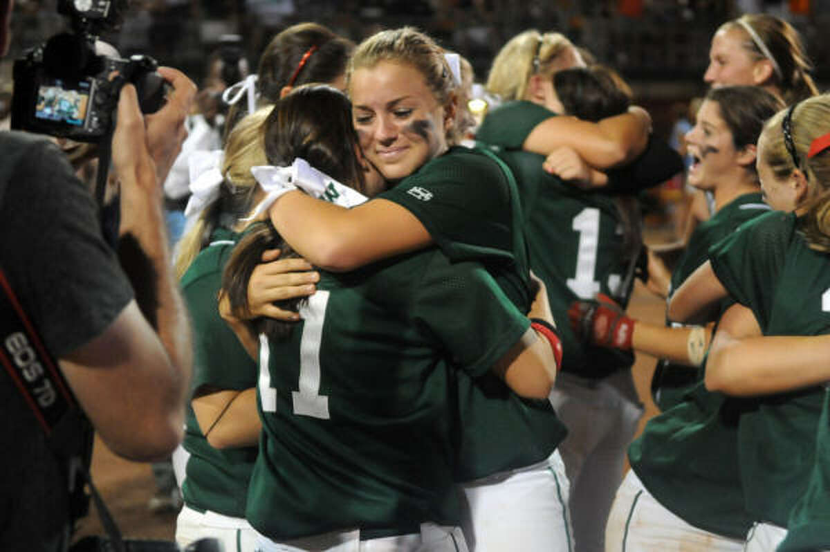 June 4: The Woodlands 7, Northside O'Connor 5 The Woodlands junior Taylor O'Dell, center, shares a hug with senior Kelsey Jolly after the Lady Highlander's win over Northside O'Connor in Saturday's Class 5A state softball championship game at McCombs Field in Austin.