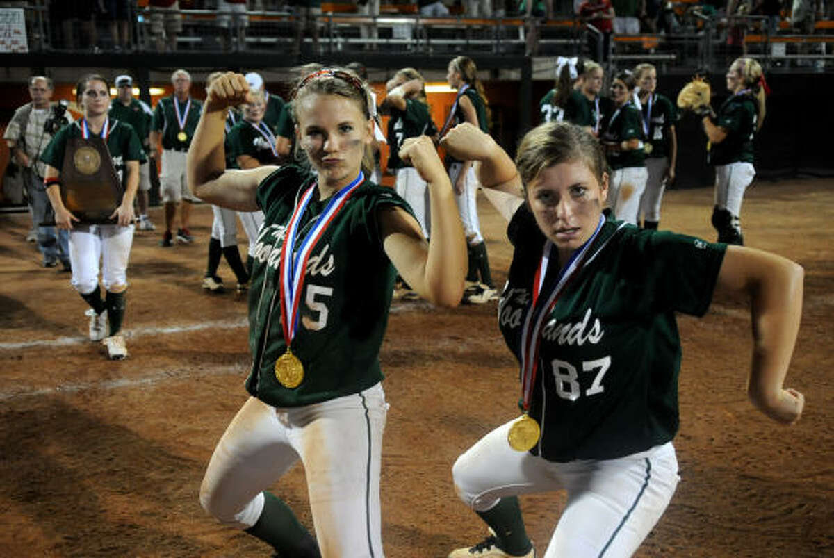 The Woodlands juniors Faith Bohack, left, and Jessica Snyder, who both homered in the fourth inning, muscle up after the Lady Highlanders' 7-5 win over Northside O'Connor.