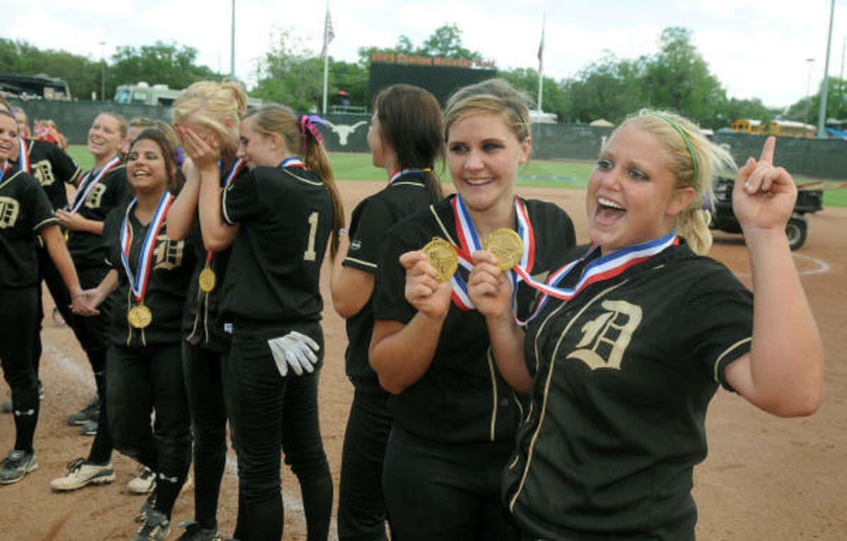 Danbury High School senior 2nd baseman and pitcher Kristin Yeager (R) and senior catcher Ashley Noak, show off their gold medals after the Panther's 9-1 win over Central Heights.