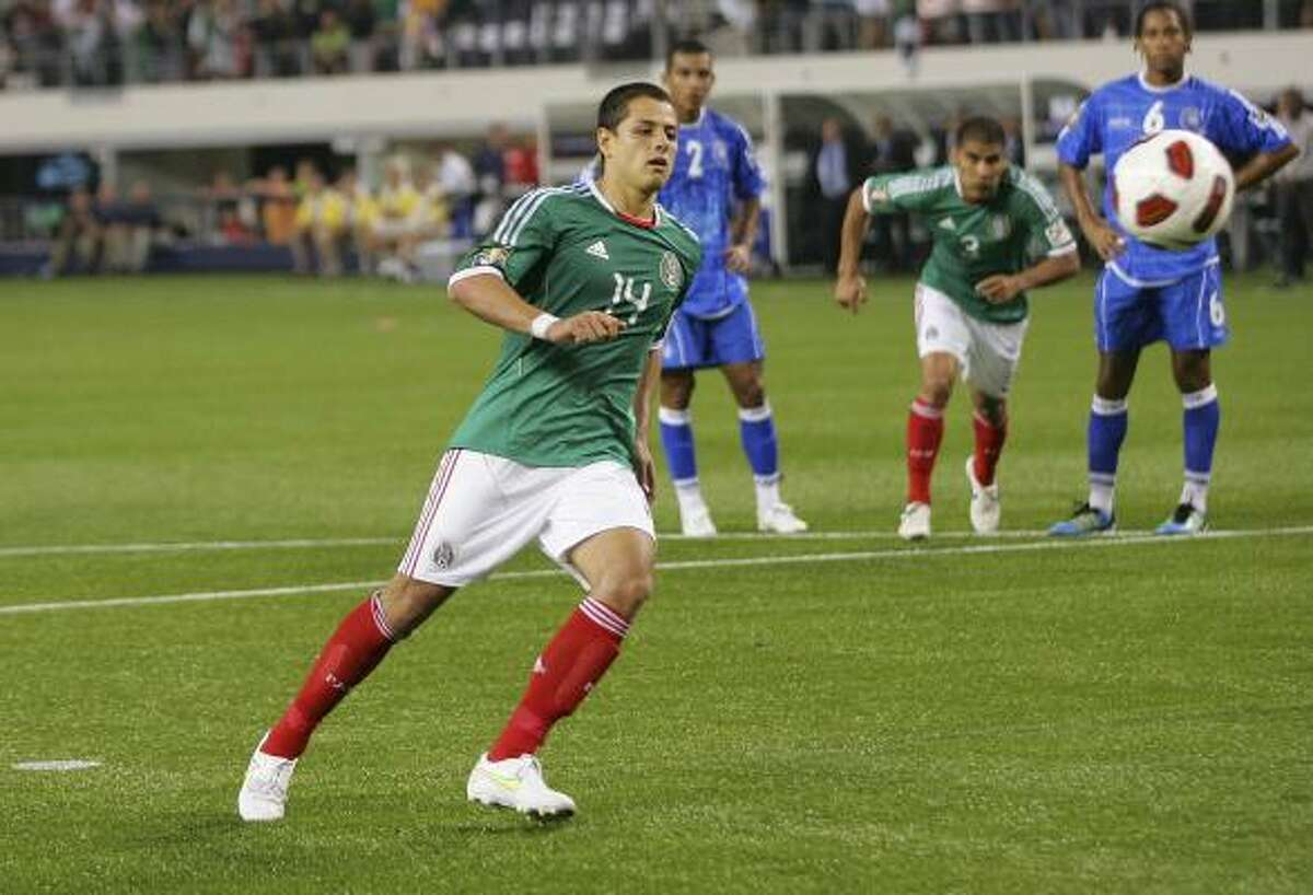 Mexico's Javier Hernandez scores on a penalty kick.