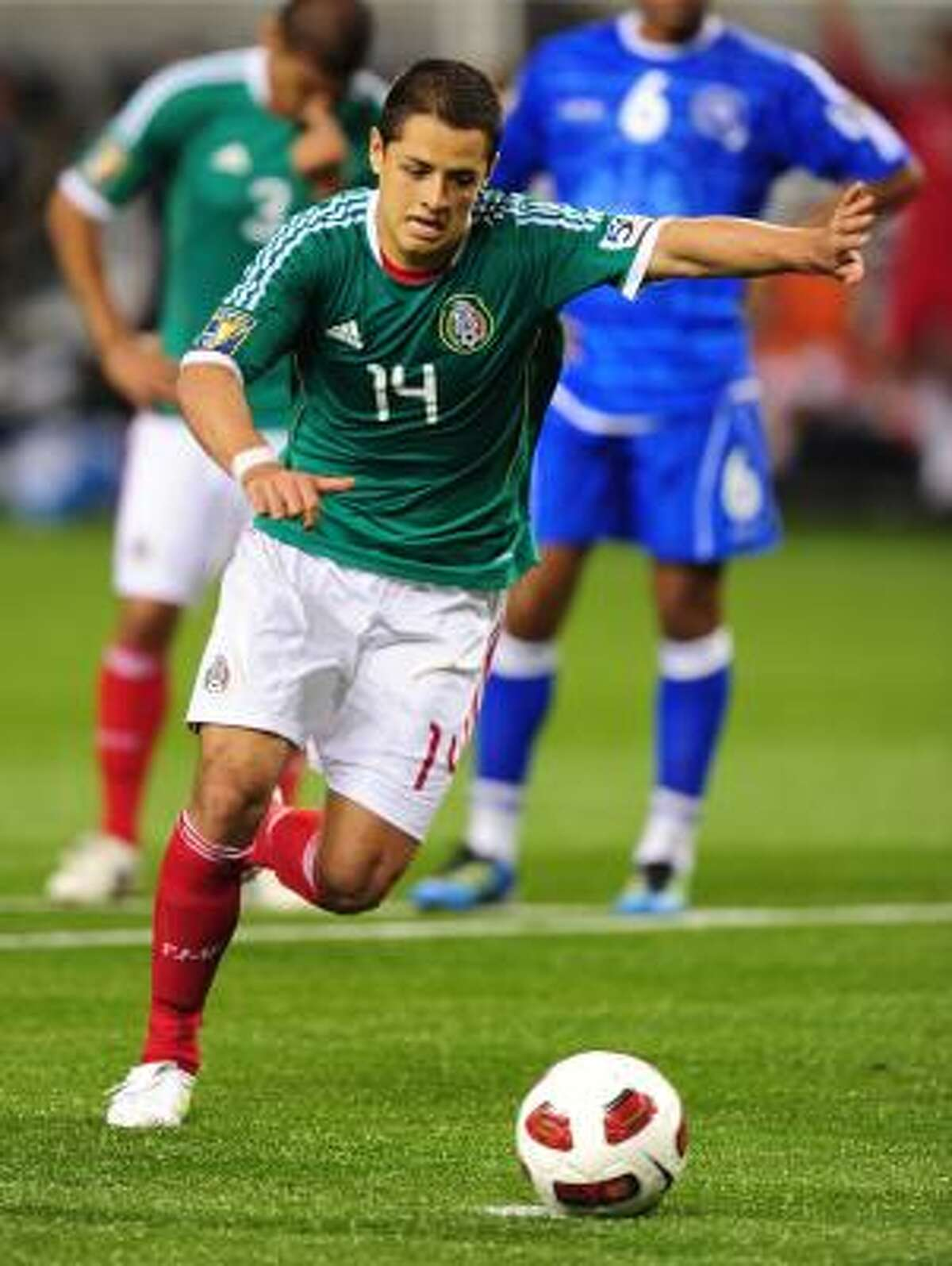 Mexico's Javier Hernández fires a penalty shot to claim his third goal.