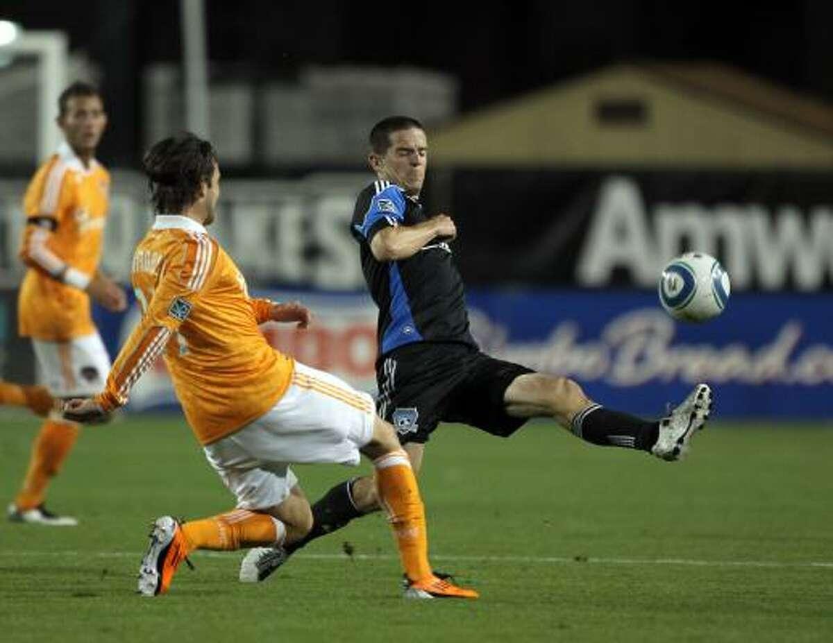 June 4: Dynamo 2, Earthquakes 0 San Jose's Sam Cronin, right, kicks the ball around Dynamo defender Mike Chabala during Saturday's match in Santa Clara, Calif.