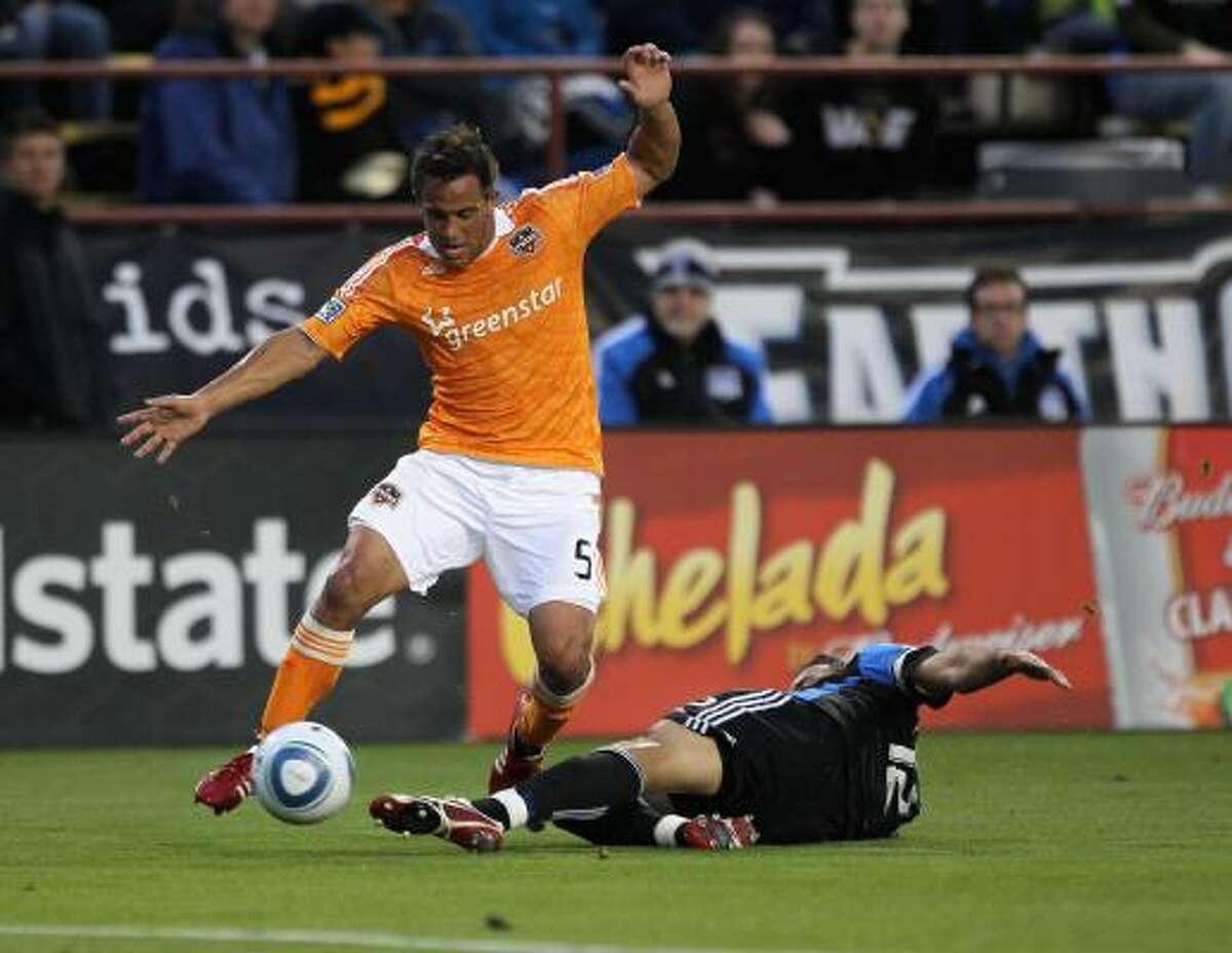 San Jose's Ramiro Corrales, bottom, tries to steal the ball from Dynamo midfielder Danny Cruz.