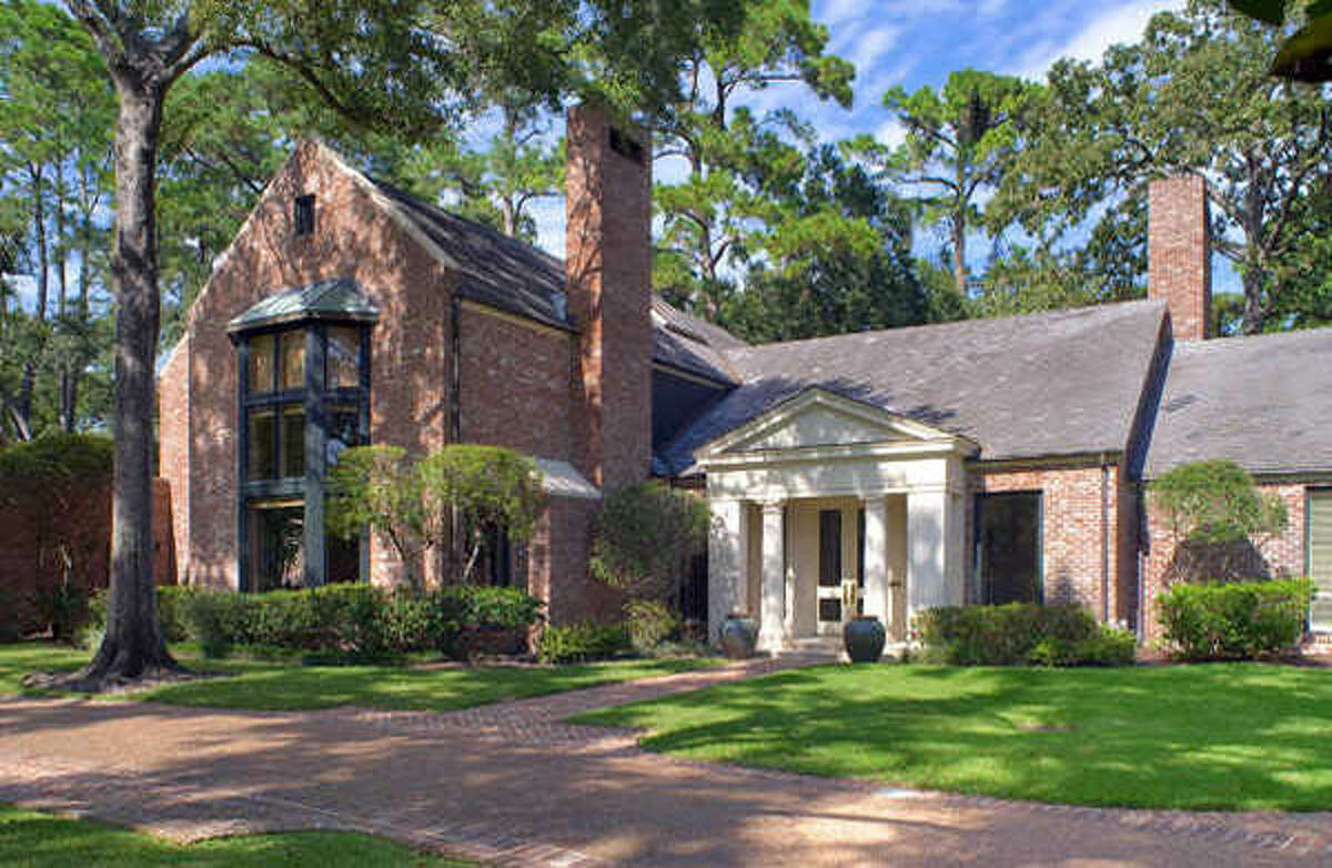 An external view of the property. Located in Harris County, this Tall Timbers estate was constructed by Tyne Parks and sits on 1.7 acres, property that is accessible only via a gated entrance.