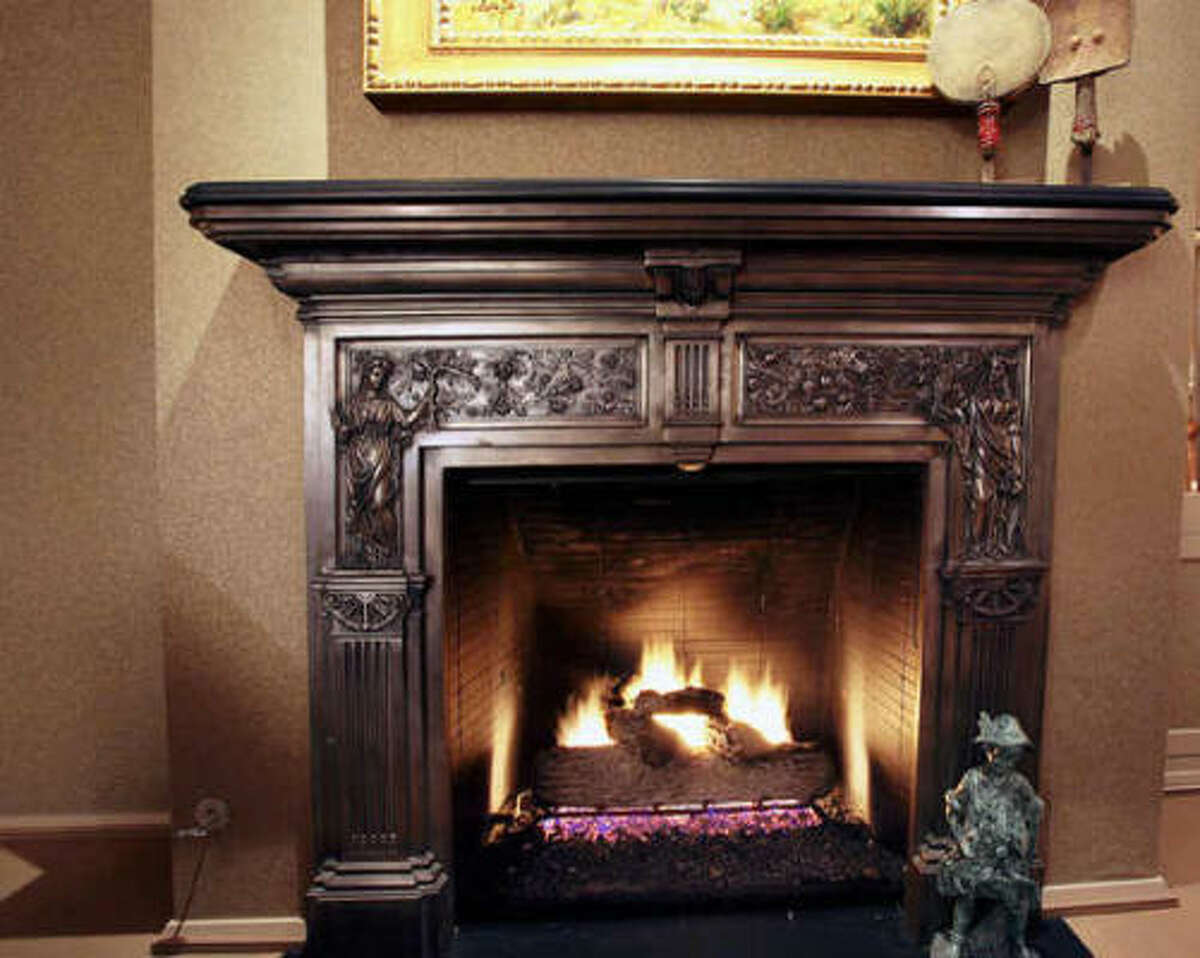 A close-up view of the fireplace. Built in 1982 but virtually rebuilt in 2007, the two-story home has 9,600-square-feet of living space.