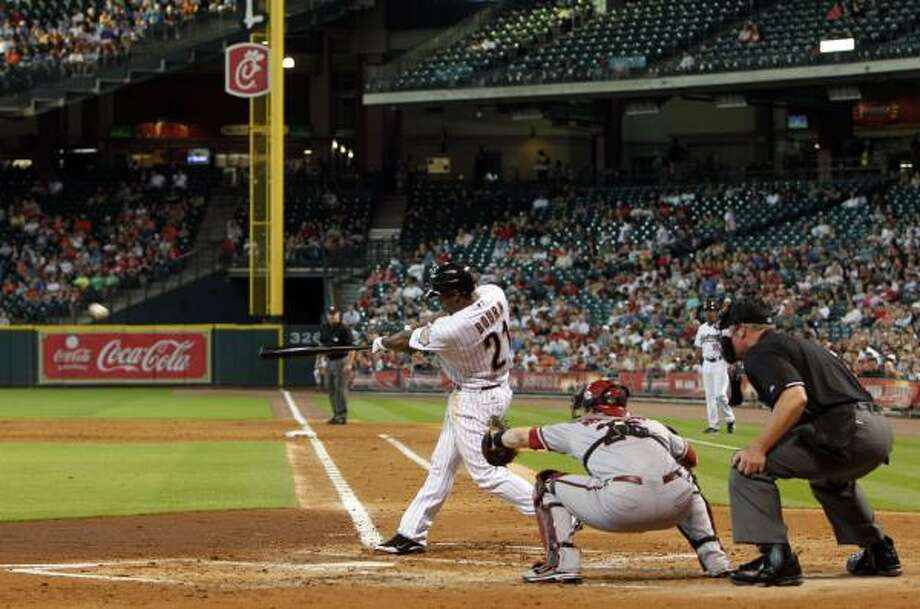Michael Bourn hits a double, scoring two runs andmaking the score 4-0 in the second inning. Photo: Johnny Hanson, Chronicle