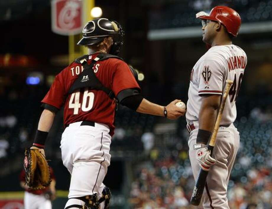 Astros catcher J.R. Towles tags out Diamondbacks first baseman Juan Miranda after he struck out. Photo: Bob Levey, Getty