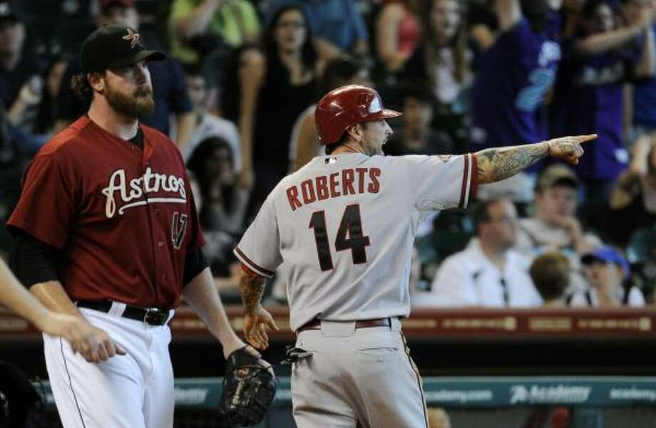 Diamondbacks second baseman Ryan Roberts points toward teammate Xavier Nady at third base after scoring on a Nady's two-run double off Astros pitcher Jeff Fulchino. Photo: Pat Sullivan, Associated Press