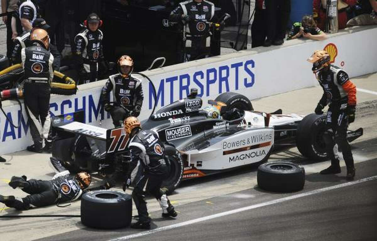 Canadian Alex Tagliani makes a pit stop before heading back to the track.