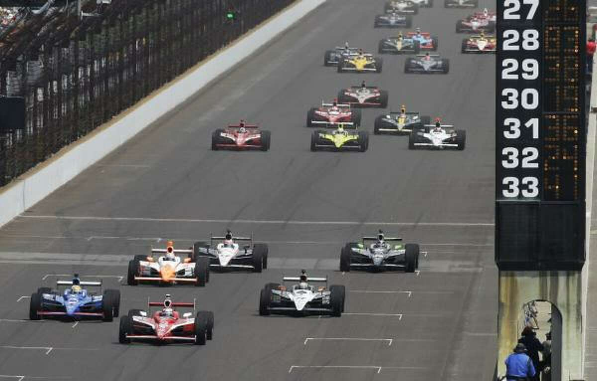 The 33-car field, led by IndyCar driver Scott Dixon of New Zealand, heads to the first turn at the start the Indianapolis 500 at the Indianapolis Motor Speedway on Sunday, May 29, 2011