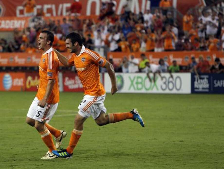 May 28: Dynamo 2, FC Dallas 2 Dynamo forward Will Bruin (12) celebrates with teammate Cam Weaver (15) after Weaver tied the game at 1-1. Photo: Johnny Hanson, Chronicle