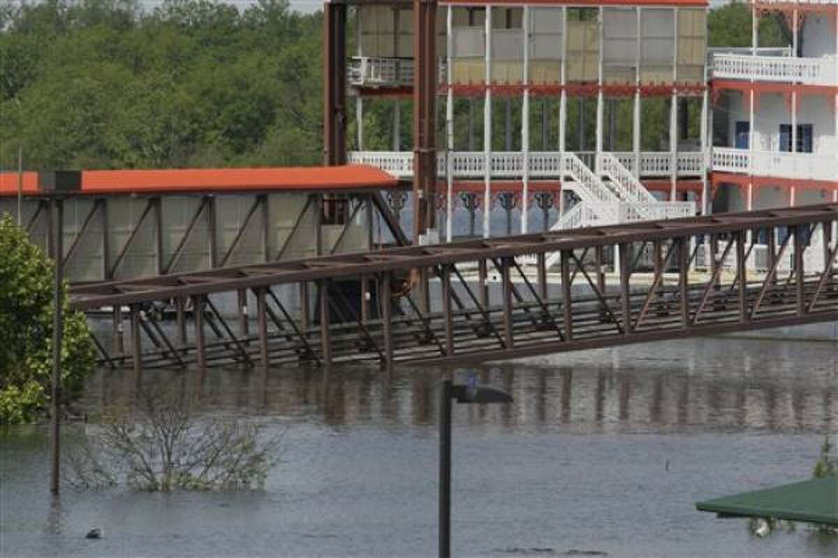 The rising waters of Lake Ferguson flood the Greenville Yacht Club in Greenville, Miss.