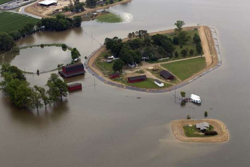 Floodwaters from the Yazoo river surround farm homes near  Yazoo City, Miss.