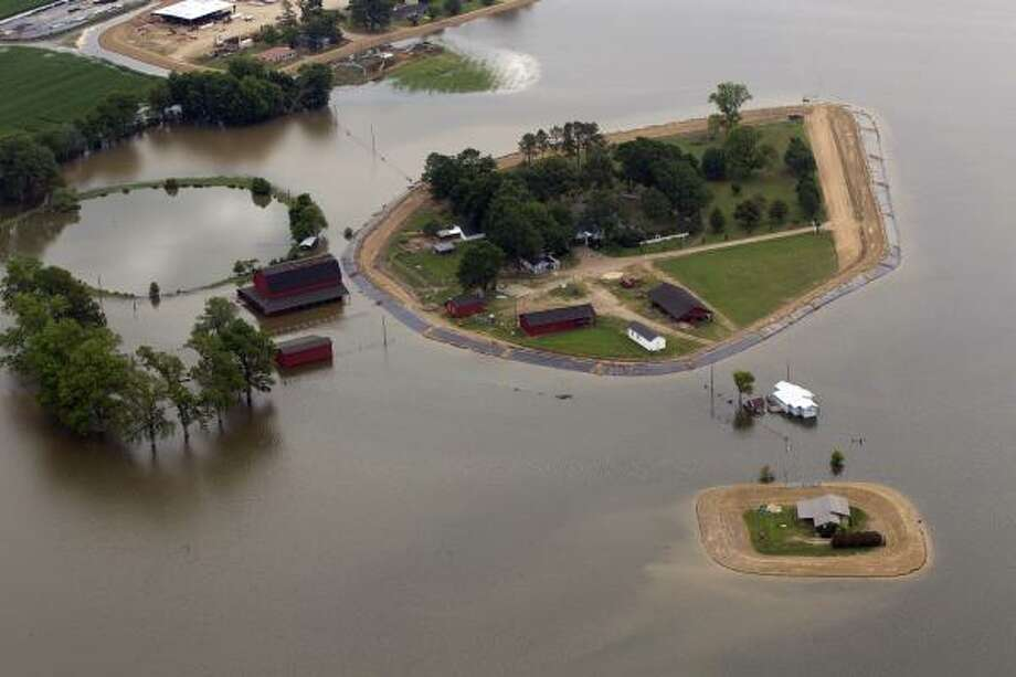 Floodwaters from the Yazoo river surround farm homes near  Yazoo City, Miss. Photo: Dave Martin, Associated Press