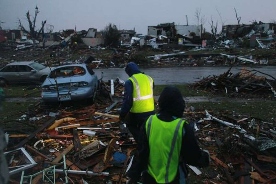 JOPLIN, MO - MAY 23:  Rescue workers search through the debris of  homes.