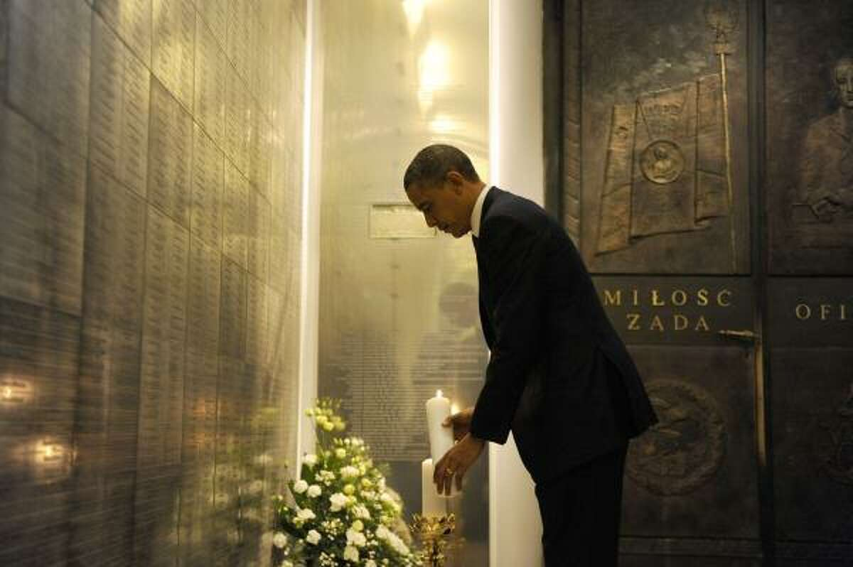 US President Barack Obama lights a candle as he visits the memorial to the victims of the Smolensk plane crash at the Field Cathedral of the Polish Military in Warsaw on May 28, 2011. Obama reassured east European allies that cooperation over missile defence with their Soviet-era master Moscow does not mean NATO will cede partial control to Russia.