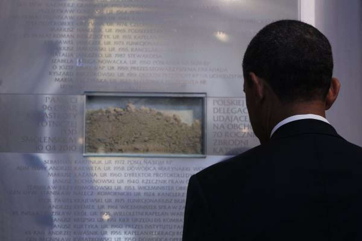 President Barack Obama visits the memorial to the victims of the Smolensk plane crash at the Field Cathedral of the Polish Military in Warsaw, Poland, Saturday, May 28, 2011.