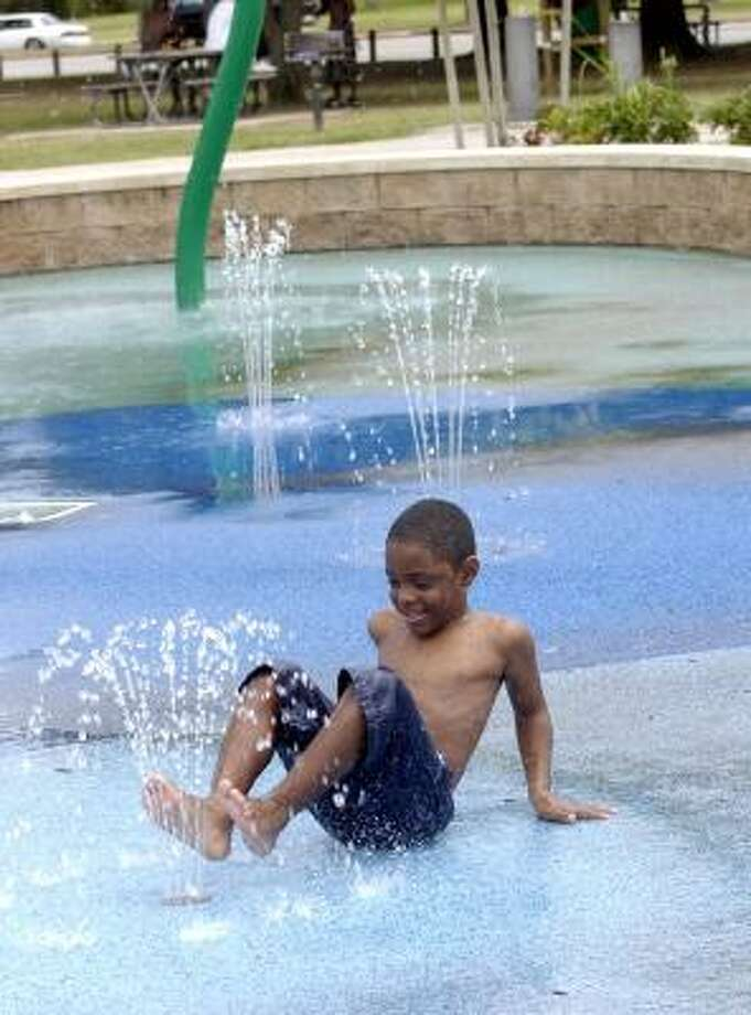 Michael Haughton, 6, enjoys playing in the Edgewood Community Center's Water Park, 06/17/05.    (Photo by Kim Christensen) Photo: Kim Christensen, For The Chronicle